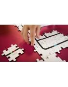 Zestawy puzzle wspomagające naukę programowania przy pomocy robotów.